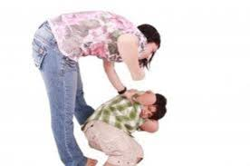 Mother beating child